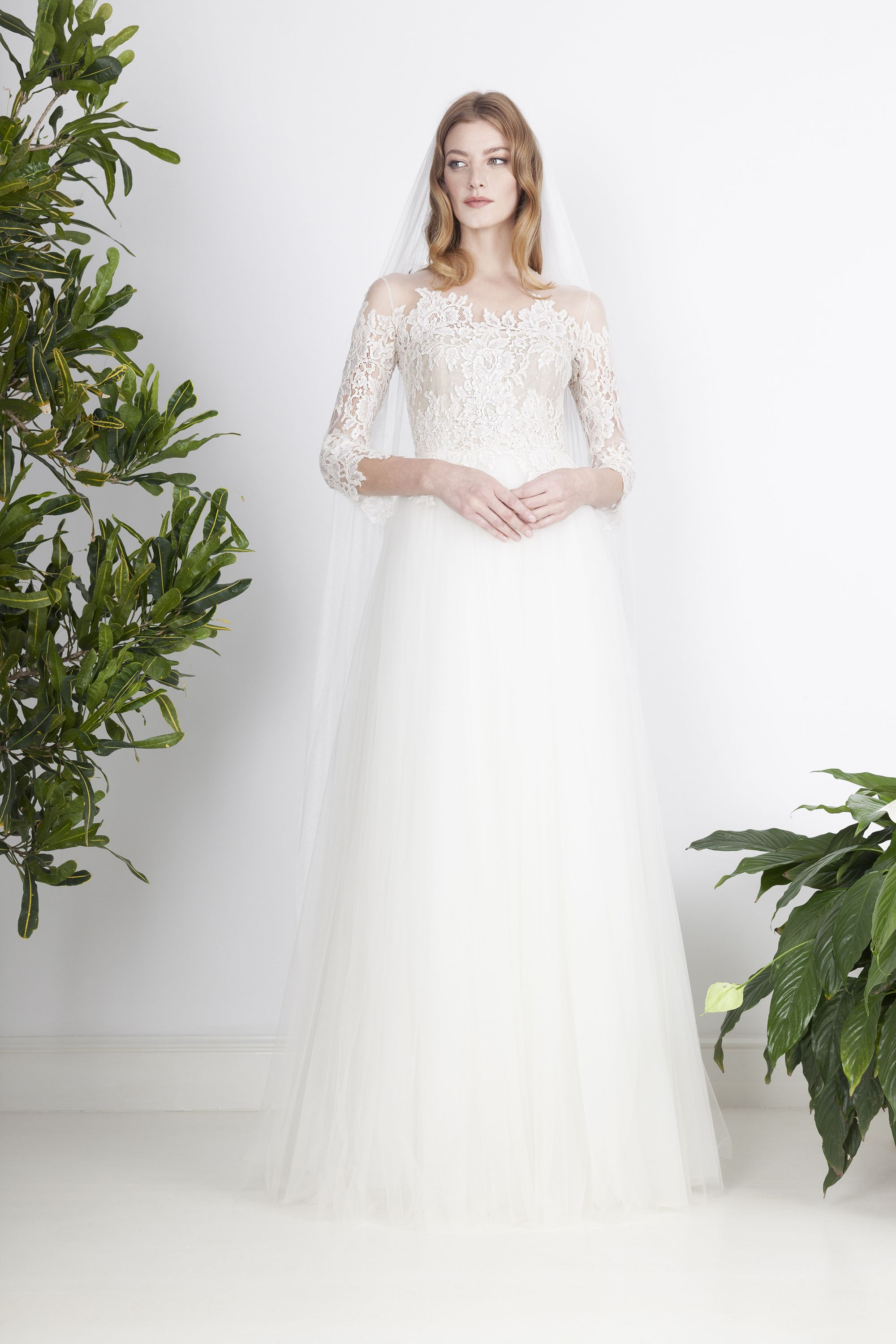Ethereal wedding dress of fine tulle layers with transparent ...