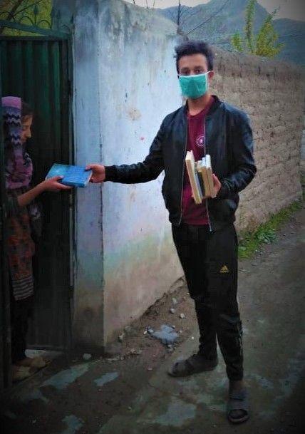 Team SEF distributes books in Booni