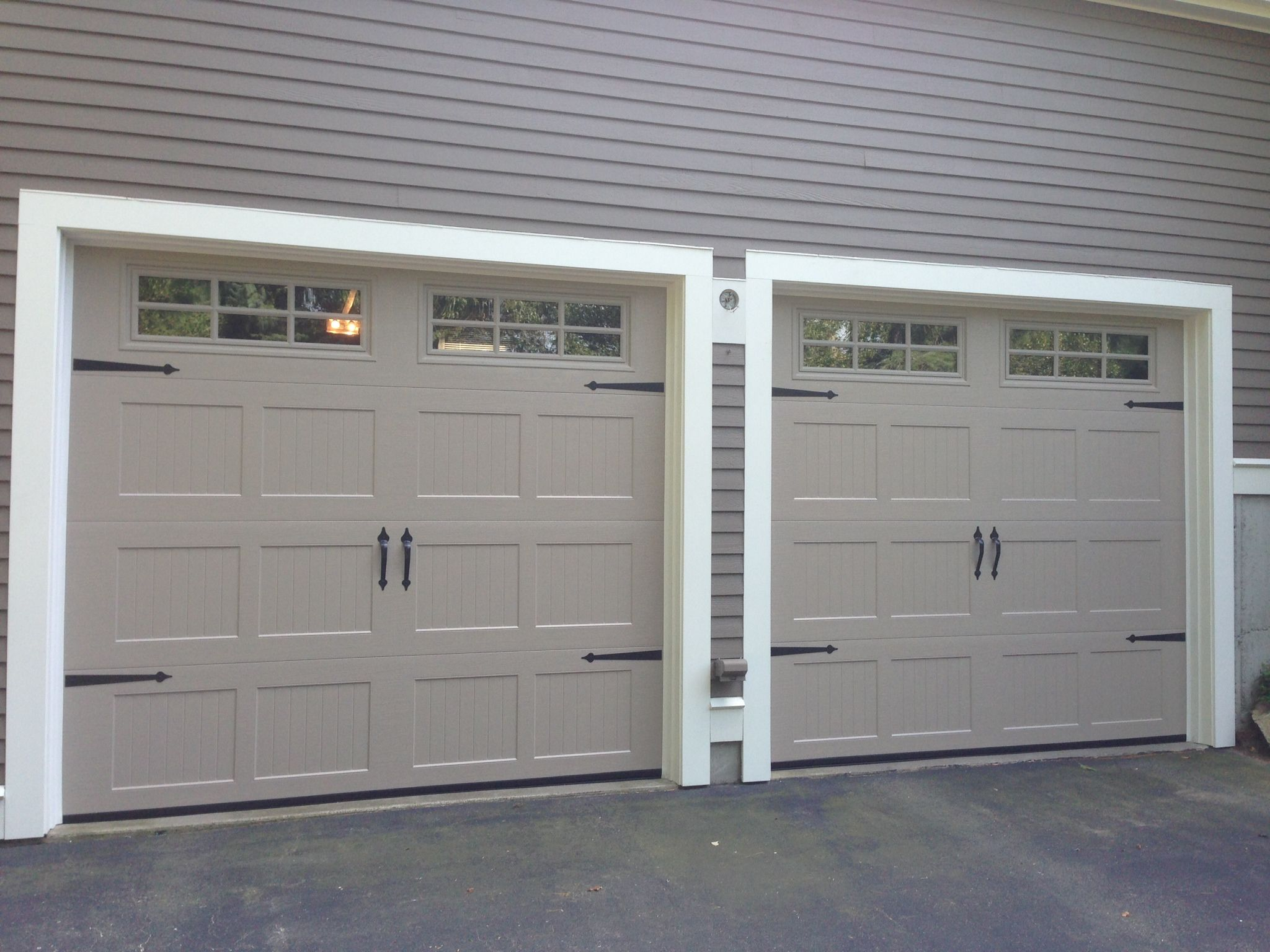 Haas model 2060 steel carriage house style garage doors in for Garage doors