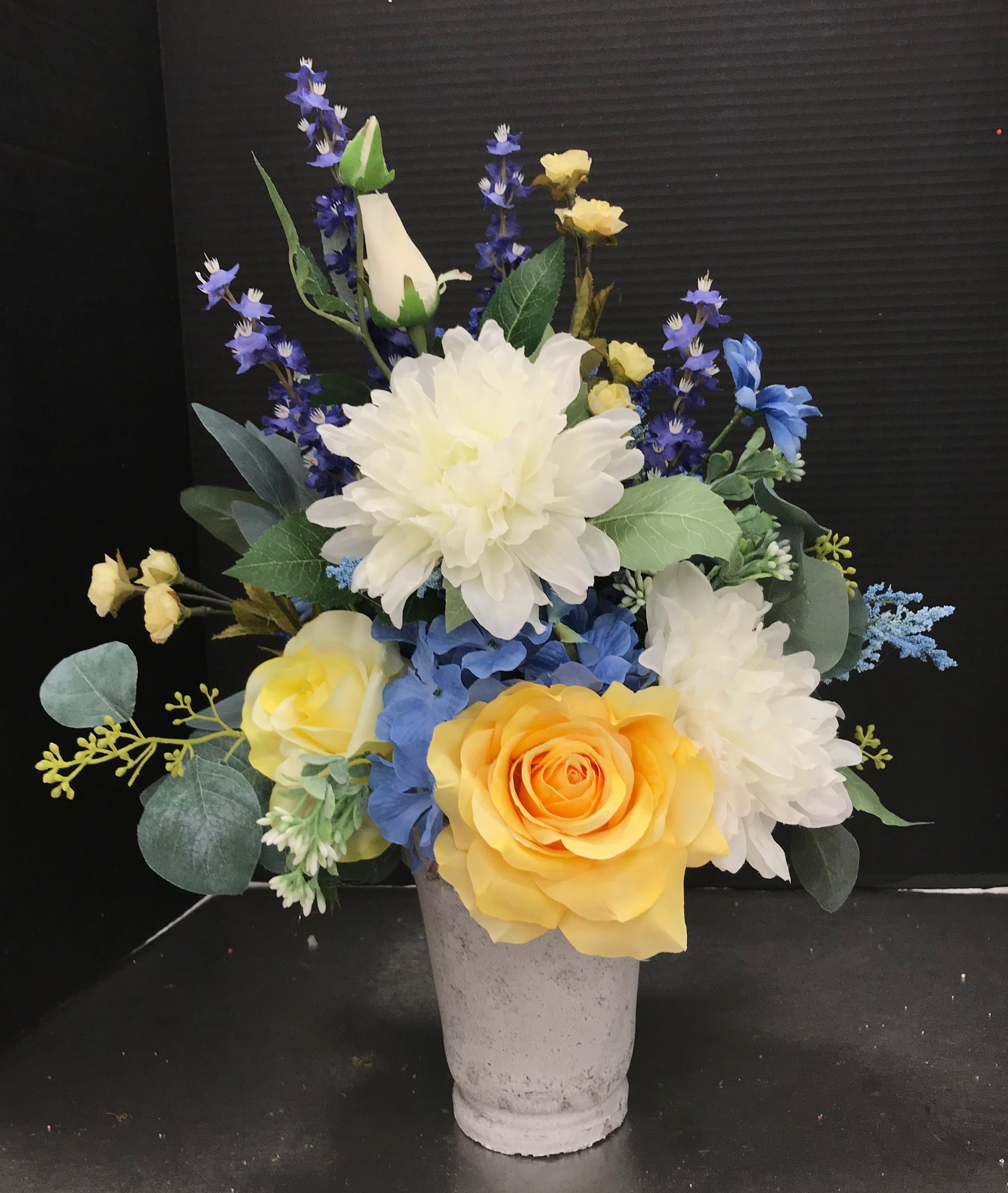 Yellow blue and white in concrete vase by andrea arreglos de yellow blue and white in concrete vase by andrea flower arrangementfloral izmirmasajfo