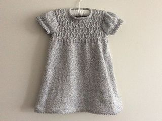 This adorable dress and leggings set is perfect for every party. The smocked detail is a joy to knit and wear.