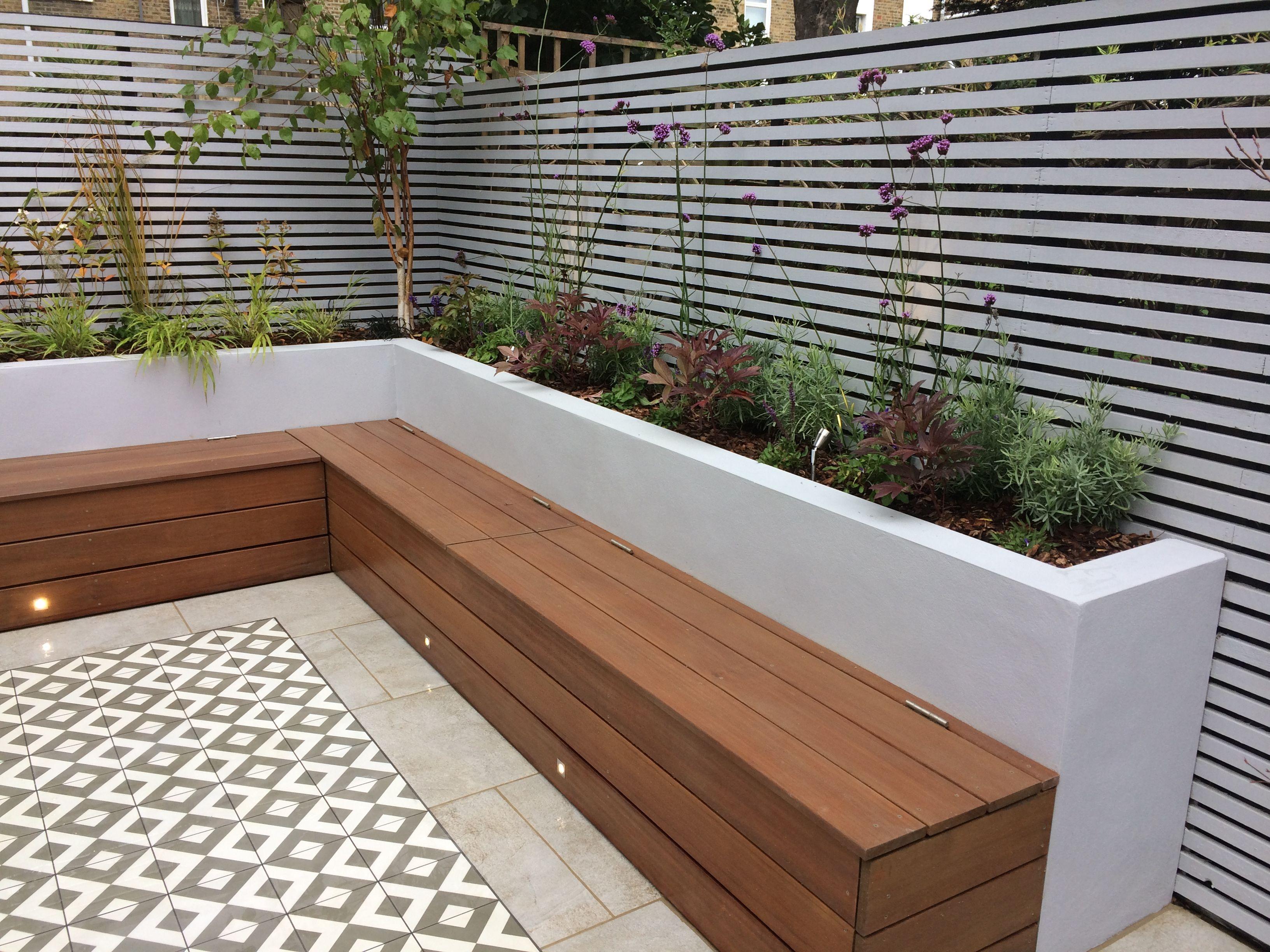 Photo of Custom hardwood seat with storage. Timber trellis screens. Perennial feature pla…