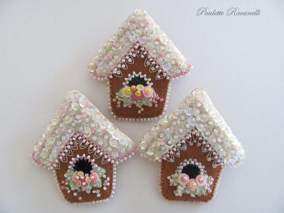 Adorable gingerbread houses stitched on felt.
