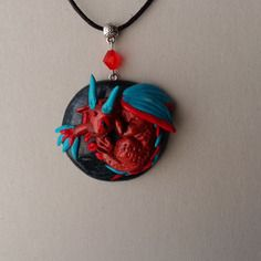 Collier fantaisie pendentif petit dragon cuivre en fimo