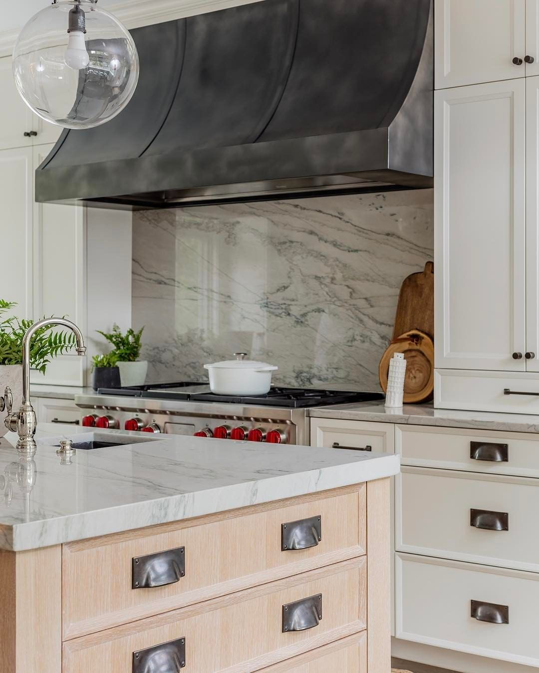 Katie Rosenfeld Design Wood Island White Perimeters Le Creuset Pot Black Hardware Marble Slab Backsplash And Counters Gl Globe Pendants