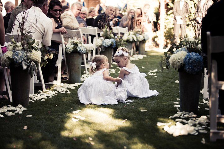 Picking up the petals instead of throwing them? that works too. :) So cute. #weddings. Www.whitelotuspro.com