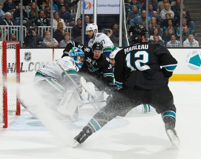 San Jose Sharks forwards Logan Couture and Patrick Marleau kick up a snow shower (Nov. 7, 2013).