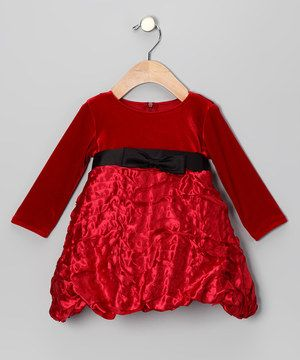When the occasion calls for special attire, look to this enchanting dress. With its soft velvet top, textured taffeta skirt and cozy long-sleeve silhouette, it's a perfect piece for little princesses.