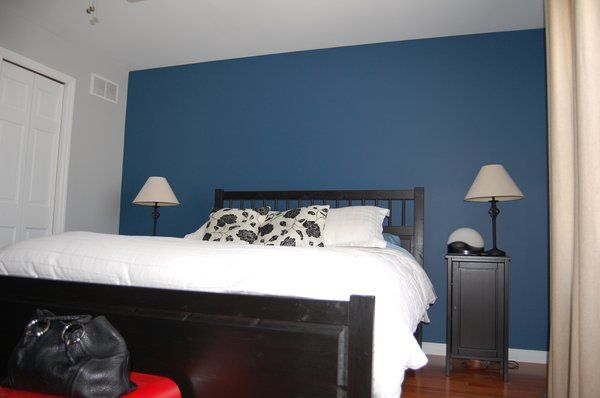 Grey bedroom with blue accent wall and white trim with - Dark gray bedroom walls ...