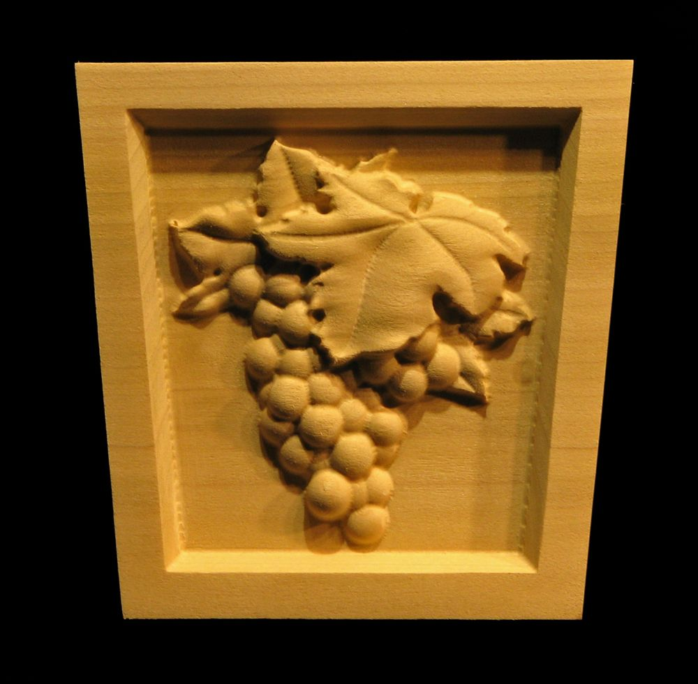 Carved wood keystone wine grapes and