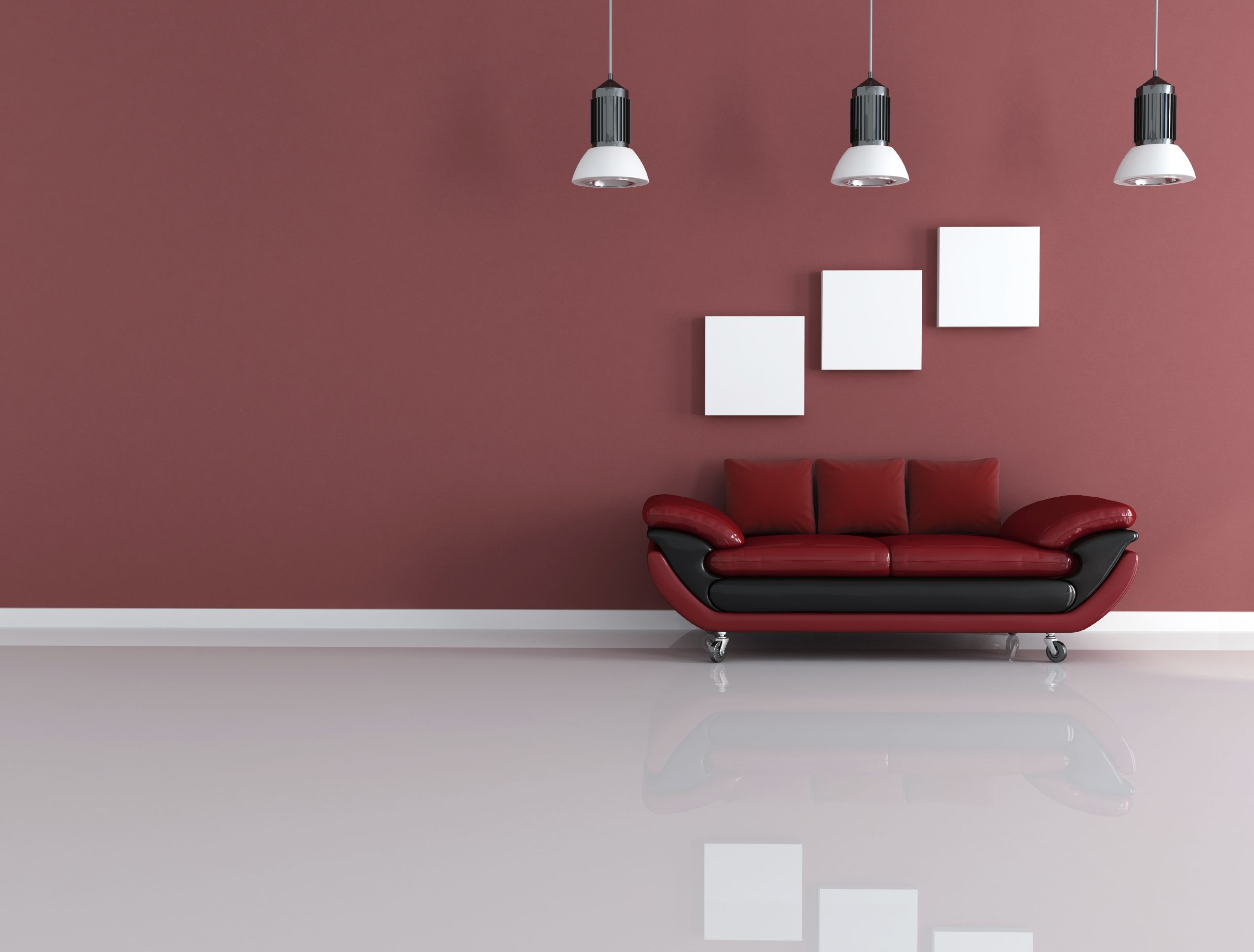 A Dark Red Wall With A Bright Red Couch