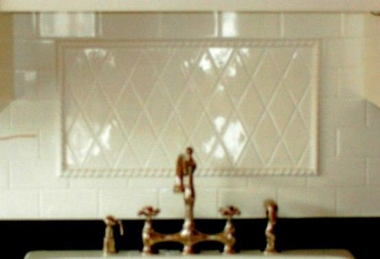 diamond and rope trim inset on white subway backsplash kitchen