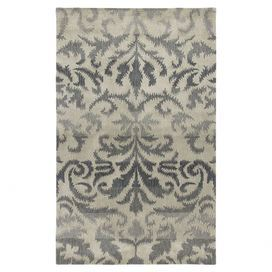 """Stylishly anchor your living room or master suite with this elegant hand-tufted wool rug, showcasing a lovely medallion motif in gray.  Product: RugConstruction Material: WoolColor: GrayFeatures: Hand-tuftedPile Height: 0.6"""" Note: Please be aware that actual colors may vary from those shown on your screen. Accent rugs may also not show the entire pattern that the corresponding area rugs have.Cleaning and Care: Rug pad recommended for use on hard wood floors"""