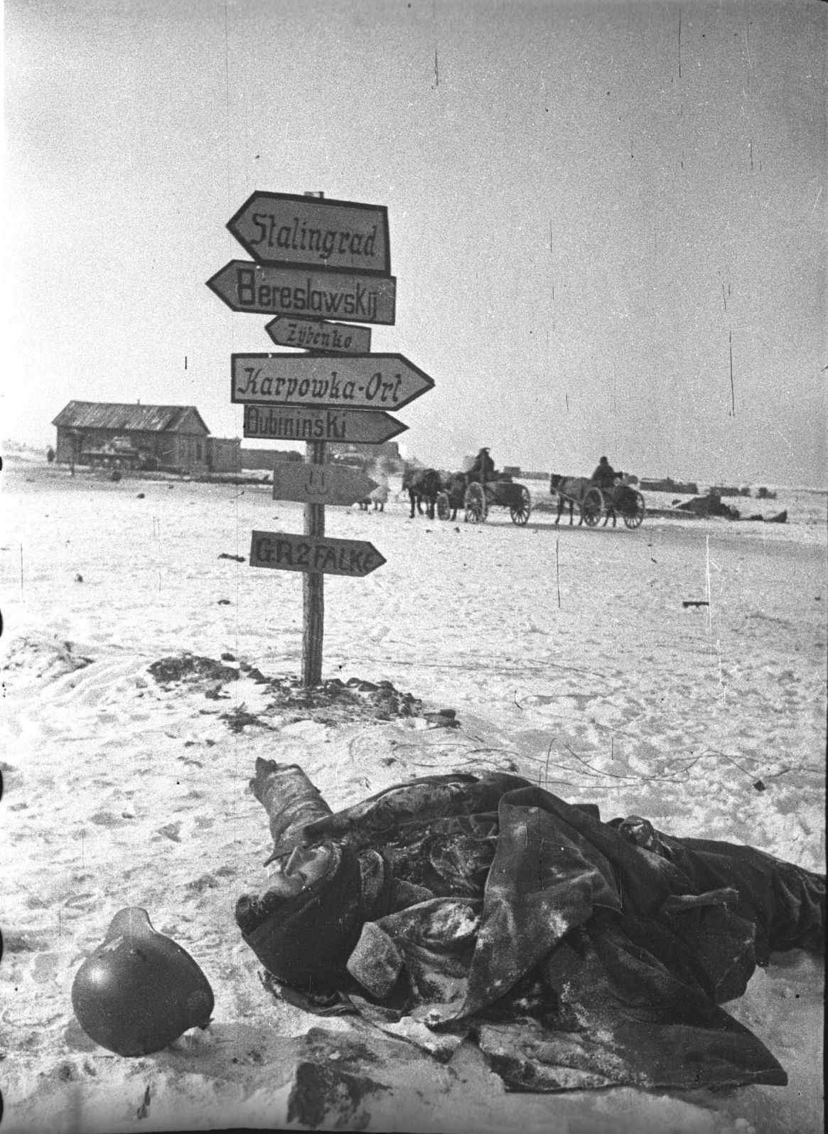 This German won't need the road signs erected in the middle of nowhere by the ever-present German army logistics. Vicinity of Stalingrad, late 1942.