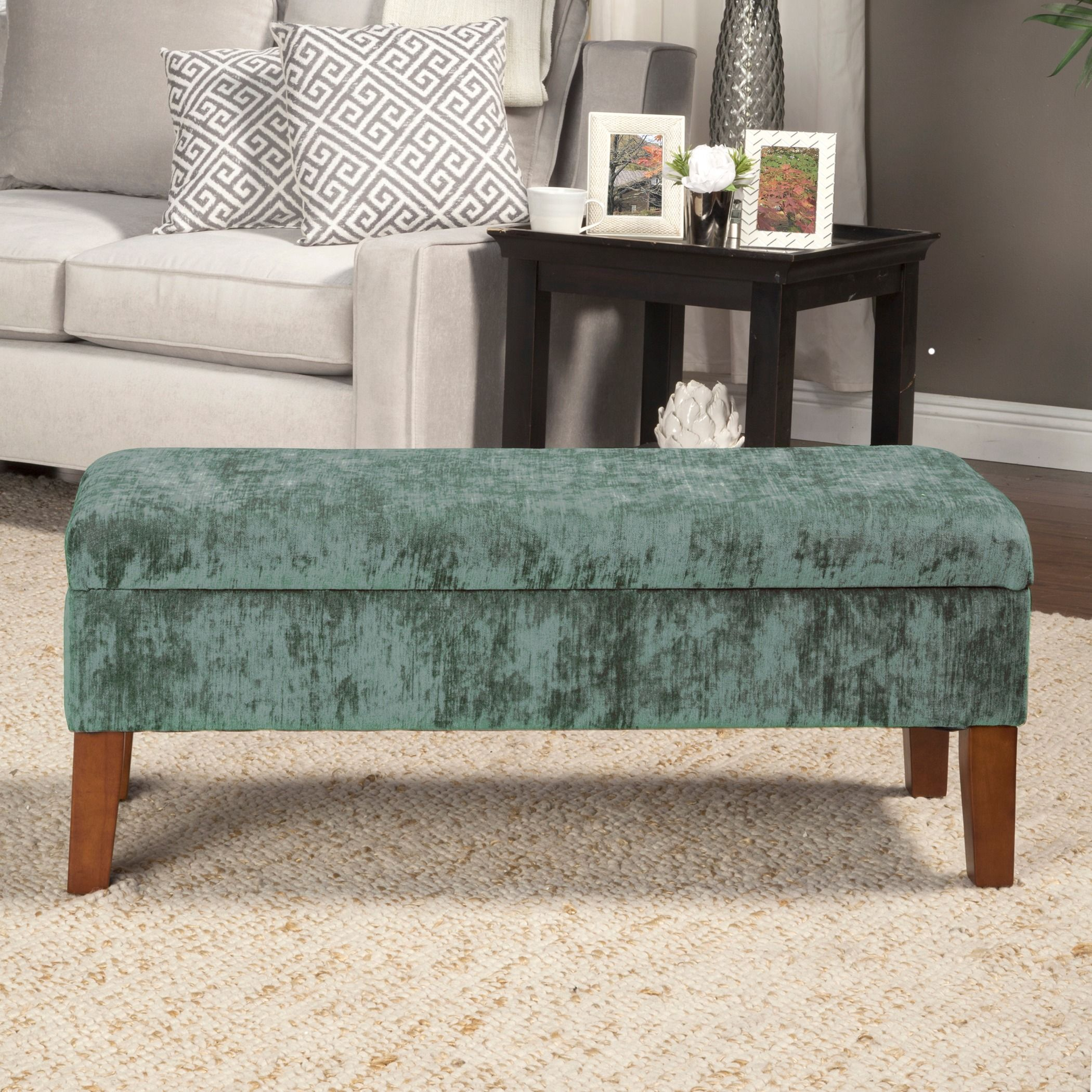 This Vibrant Velvet Teal Storage Bench Sits Atop Solid Wood Legs In A Brown  Finish.
