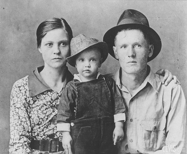 Elvis as a child with his mother and father