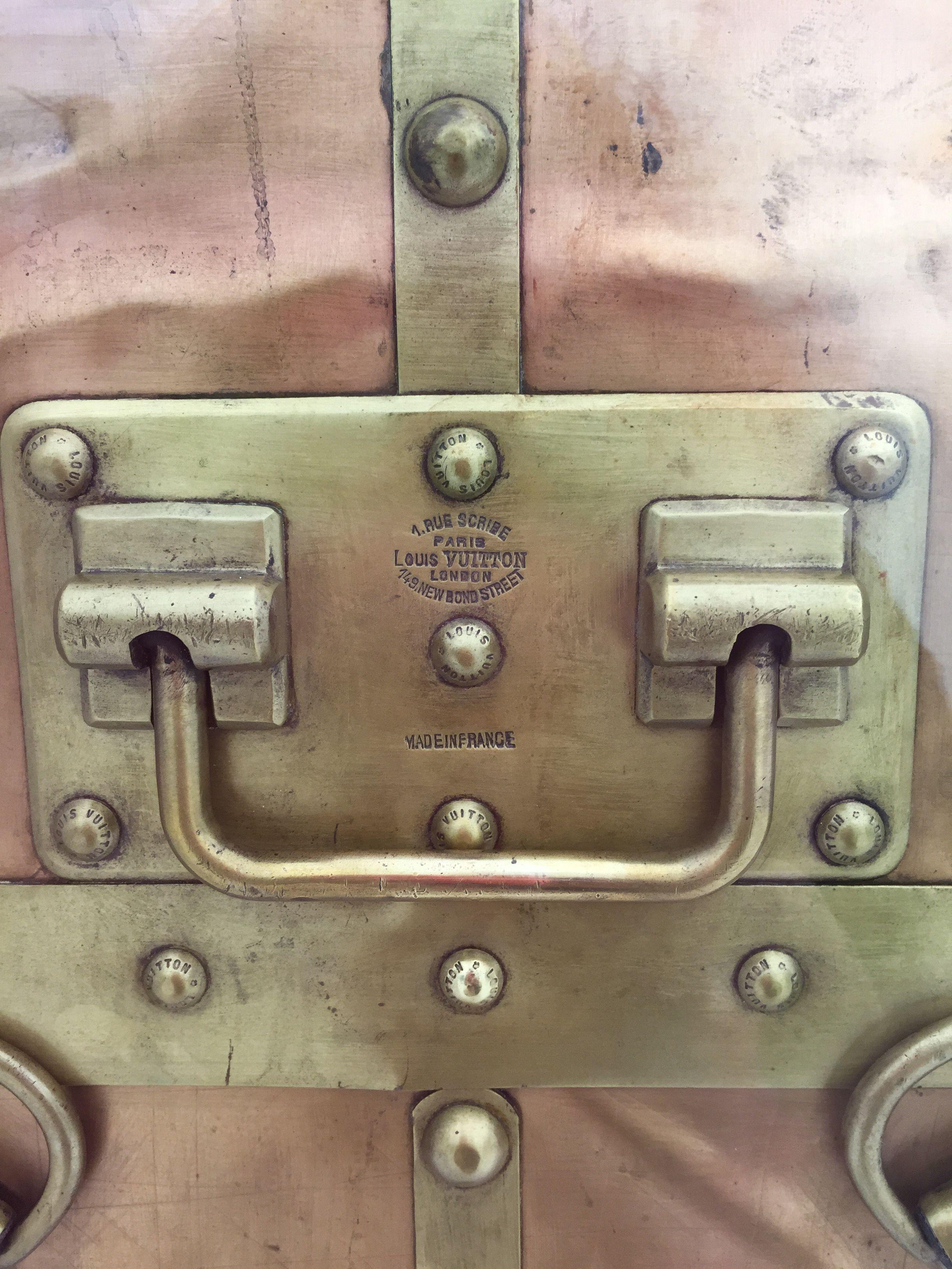 The hardware on a 1908 LV brass trunk. (Photo by Elizabeth Thankful Shannon.) #Vuittonexhibit #vintageVuitton