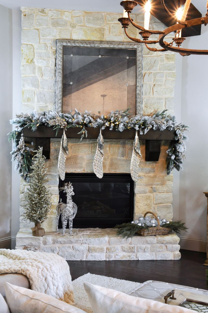 A Rustic Holiday Mantle With Flocked Garland Decor Gold Designs Christmas Mantle Decor Rustic Christmas Mantle Holiday Mantle