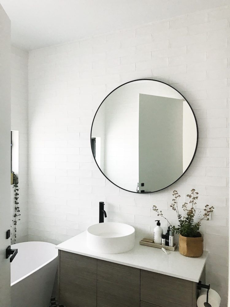 ffa9b9d393 Large black round mirror in bathroom. Check out all the photos of this  contemporary black and white bathroom and find details about all the  suppliers.