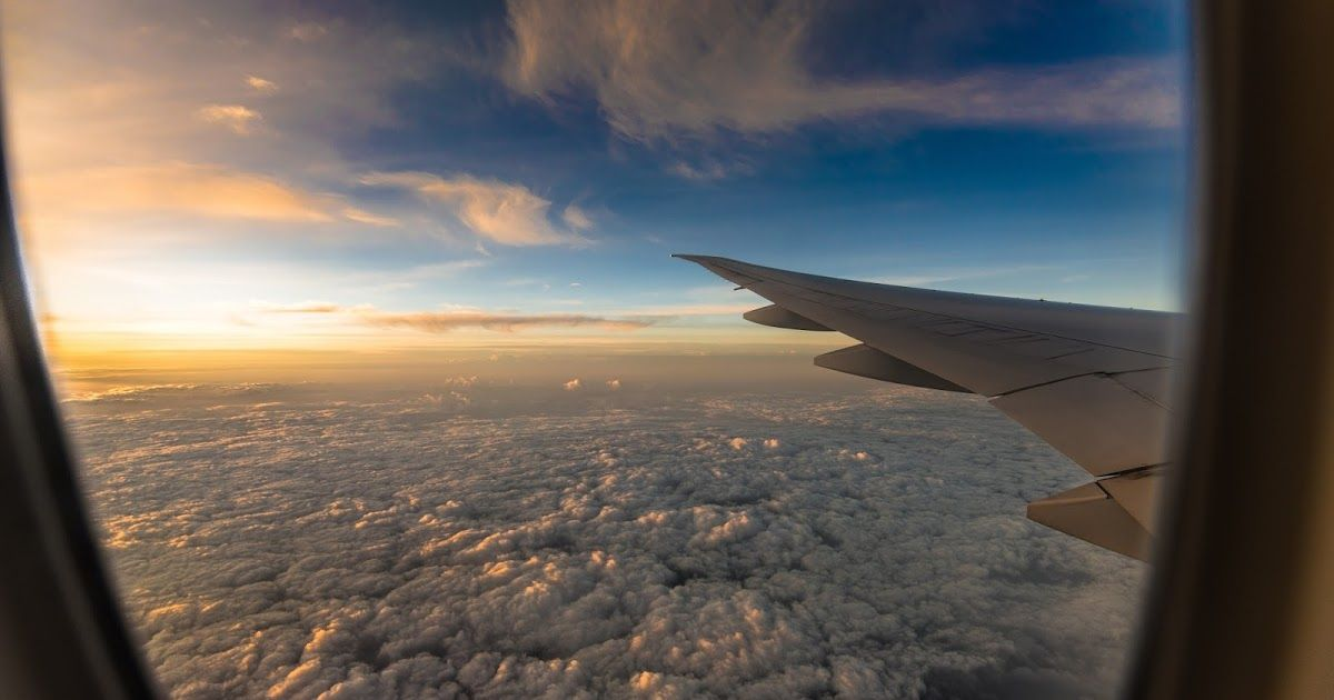 View Out The Plane Window Desktop Wallpaper Wallpapers Airplane Clouds Cloudscape Horizon Plane Sky Sunset Sunsetp Fear Of Flying Trip Cheap Flights