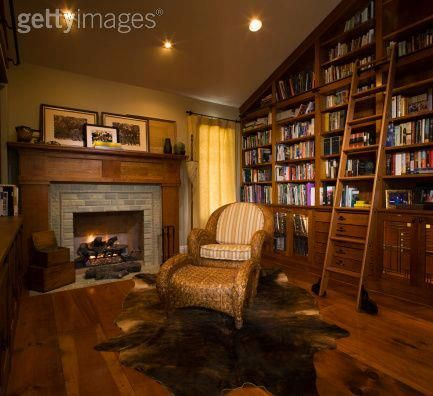 Cozy Home Library With Fireplace This Modest Includes Many Of The Traditional Elements A Built In Wood Shelves Rolling