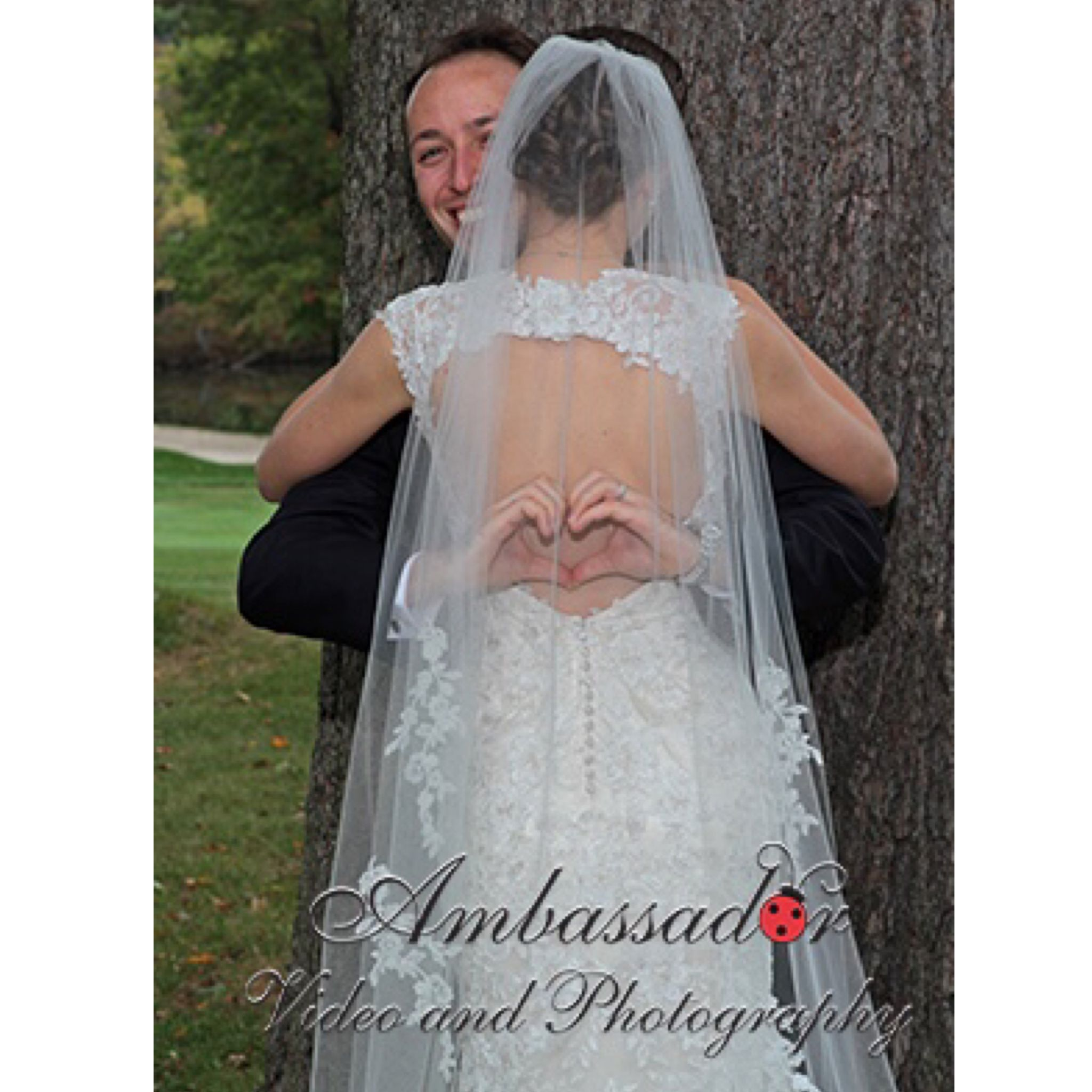 A beautiful bride in a relaxed pose wedding picture ambassador