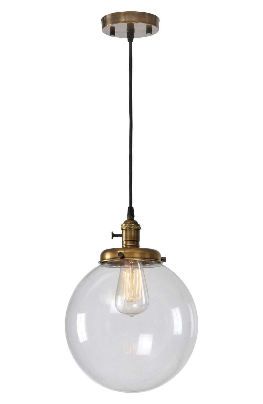 A sparkling clear globe shade and antiqued brasstone hardware pair up on this stylish light fixture with vintage appeal
