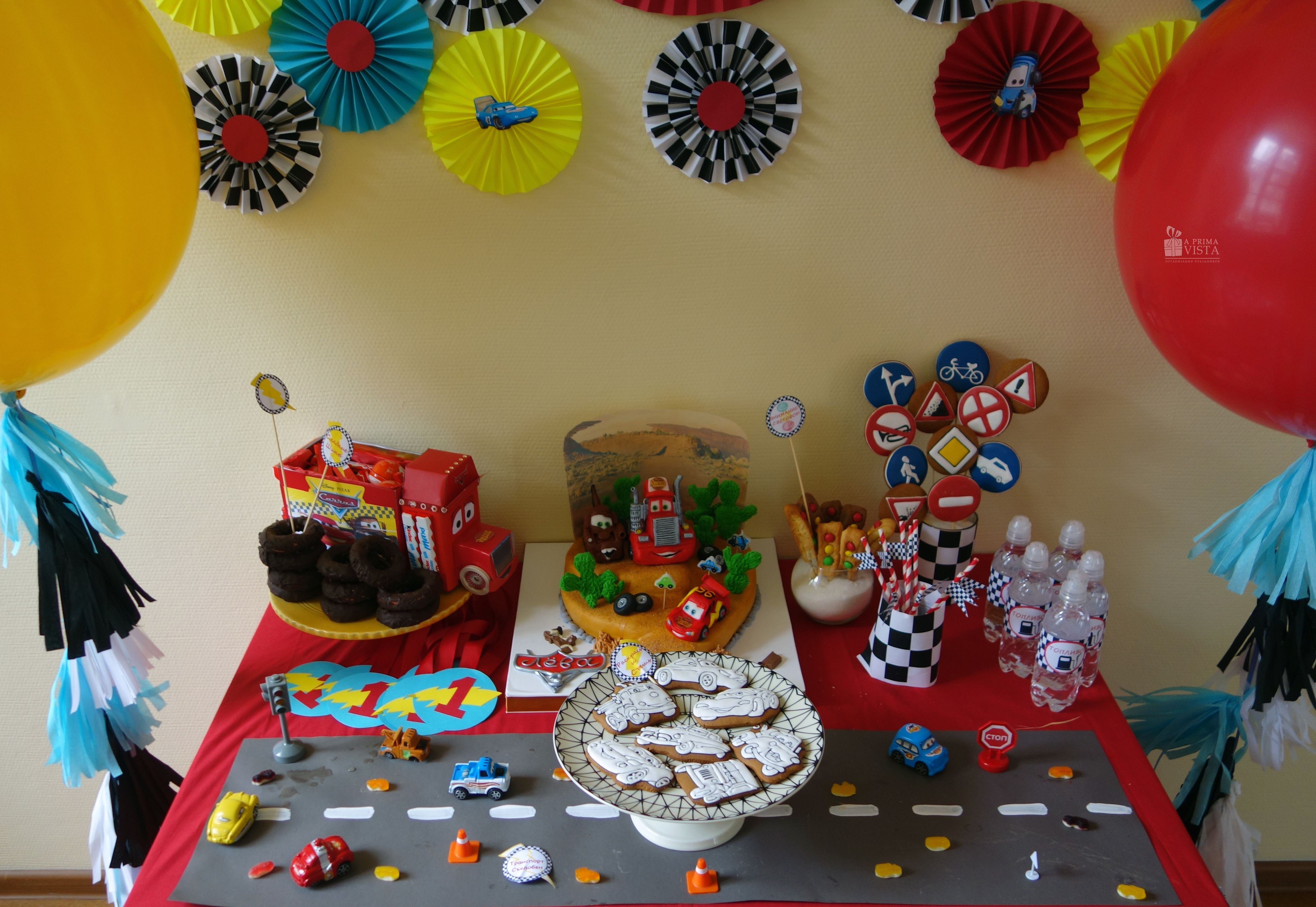 Candy bar. Paper decor. Cars style. 3d birthday for boy. Cartoon. McQueen. Balloons. Tassel garland. Tussel garland. Ginger cookies. Fuel. Cake.