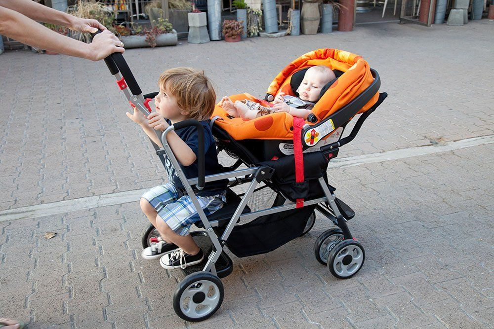 Joovy Caboose Stand On Tandem Stroller with car seater