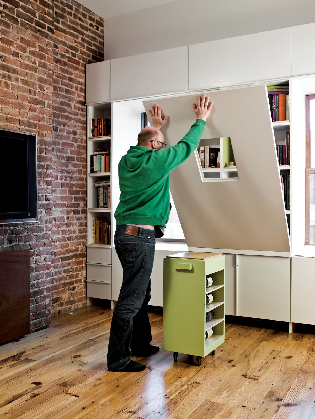 space saving apartment furniture. Multifunctional Furniture Can Be More Than Just Space-saving. In A Brooklyn Apartment, Fold-down Dining Table Also Conceals Bookshelves When Its Space Saving Apartment N
