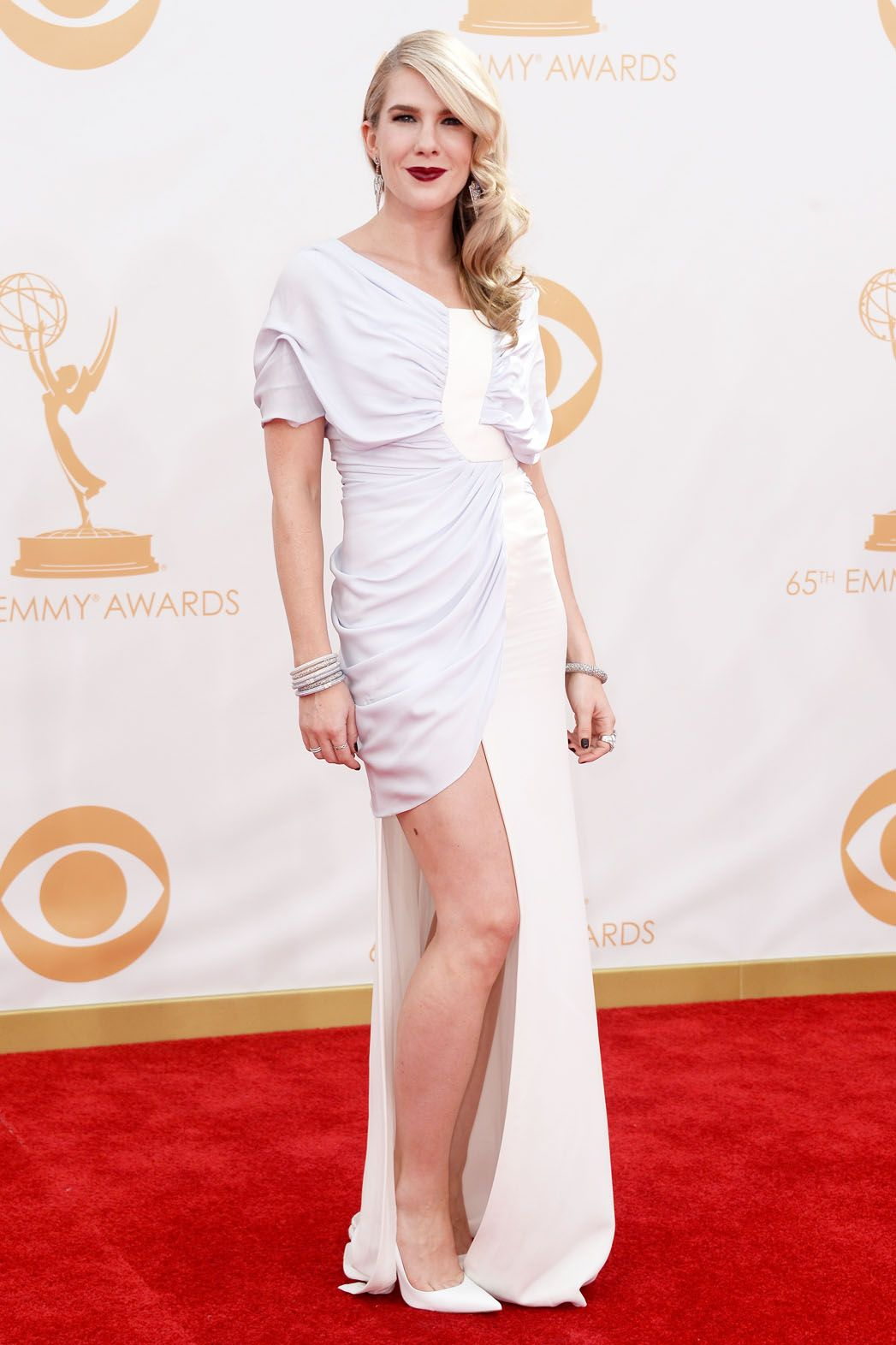 American horror story actress lily rabe in a classic white highslit