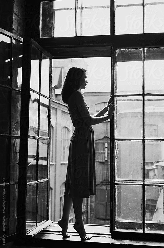Woman standing on the window in old house by Liubov Burakova | White  photography, Black and white portraits, Black and white photography