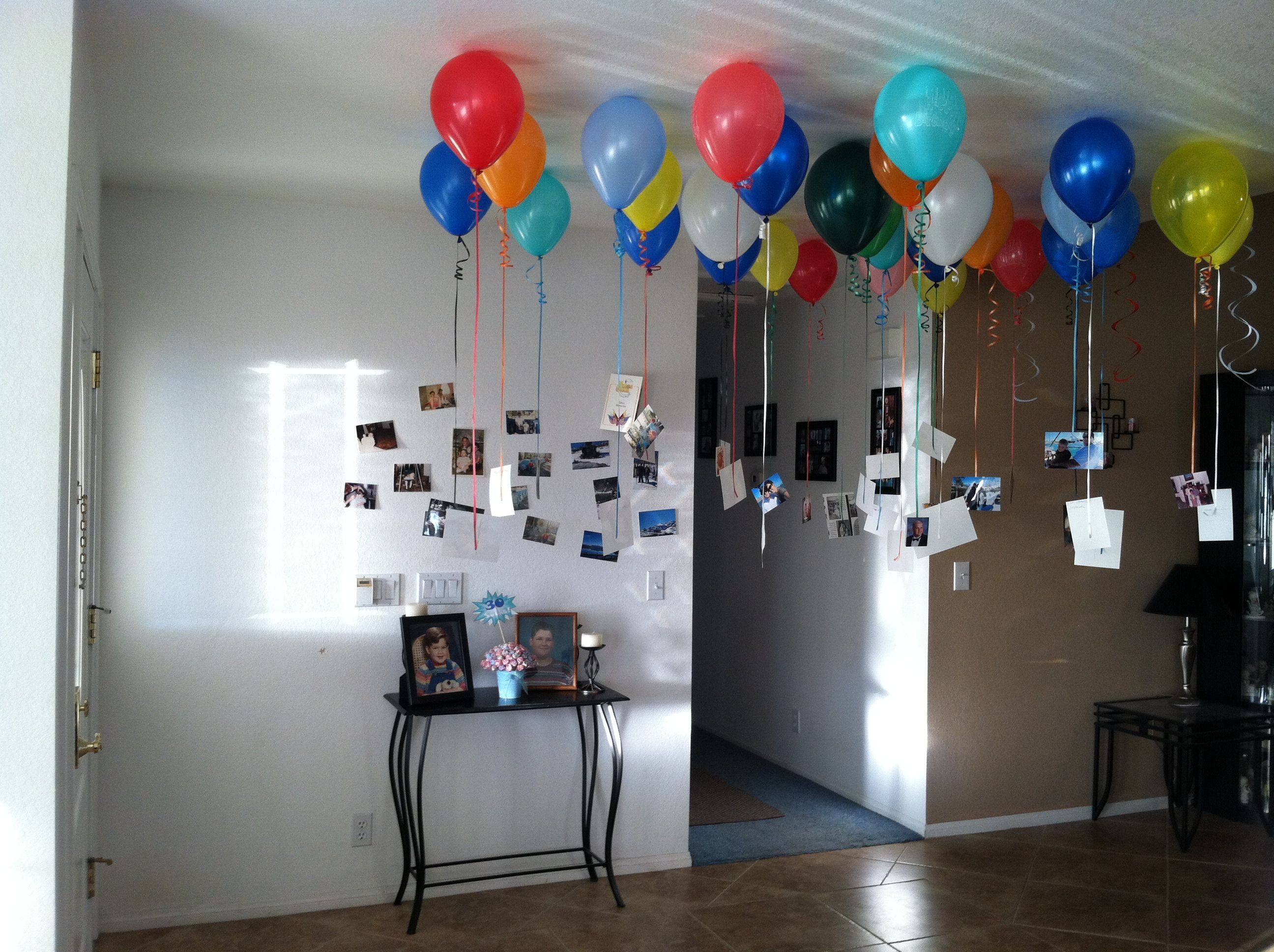Did this in my entry way for husbands 30th birthday30 balloons
