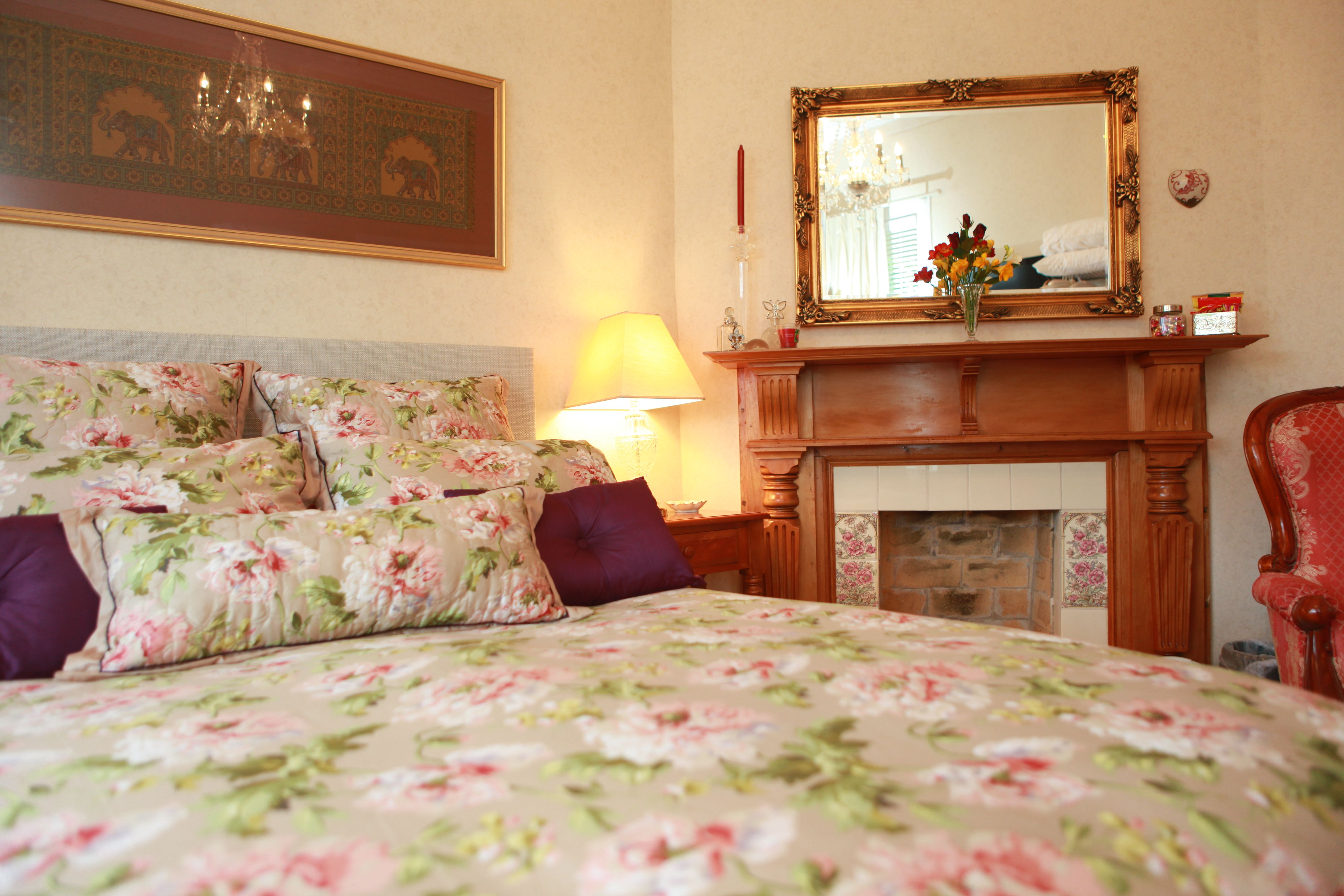 Relax in our Premiere Queen Size Room with fireplace and