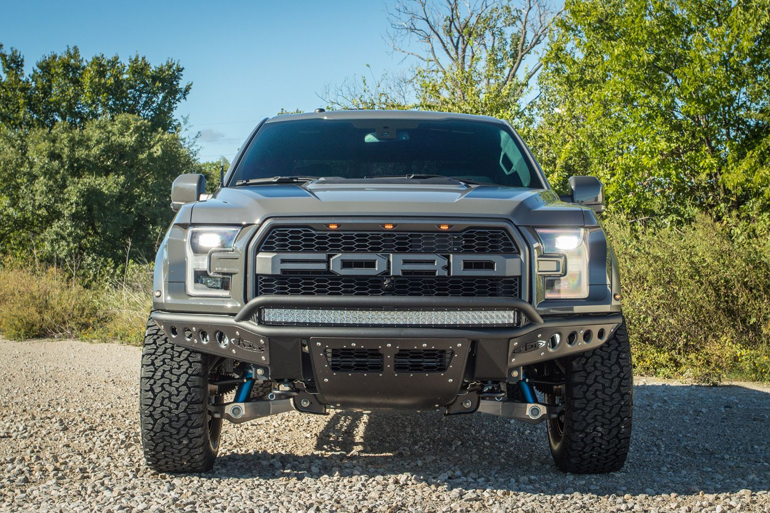 Front View Of A 2018 Ford F 150 Raptor With Add Stealth R Front Bumper With Rigid Led Light Cubes And Light Bars In Lead Foot Gra Fuel Wheels Ford F150 Bumpers