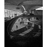 (1962) by Ezra Stoller. A high-contrast photo of Eero Saarinen's TWA Terminal interior, showing stairs, concourse, and mezzanine.