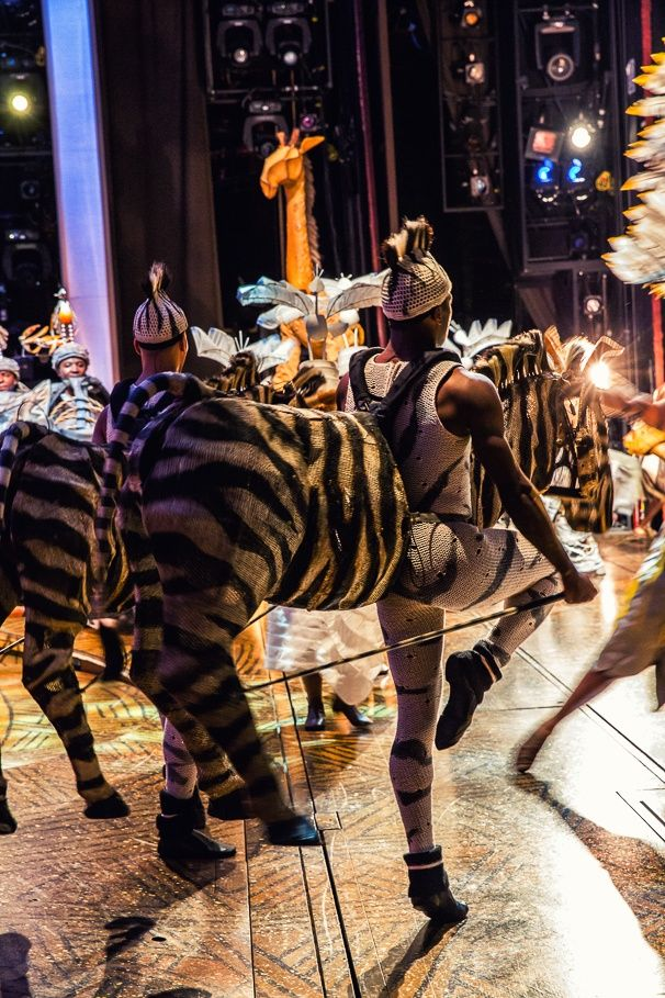 The cast of THE LION KING swarms the stage for the show's spectacular finale.