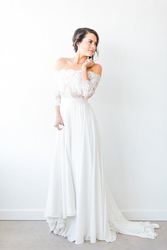 4cab64b9a1b82 This off the shoulder fall wedding gown has long sleeves but still manages  to slip us a better view of the bride's shoulders.