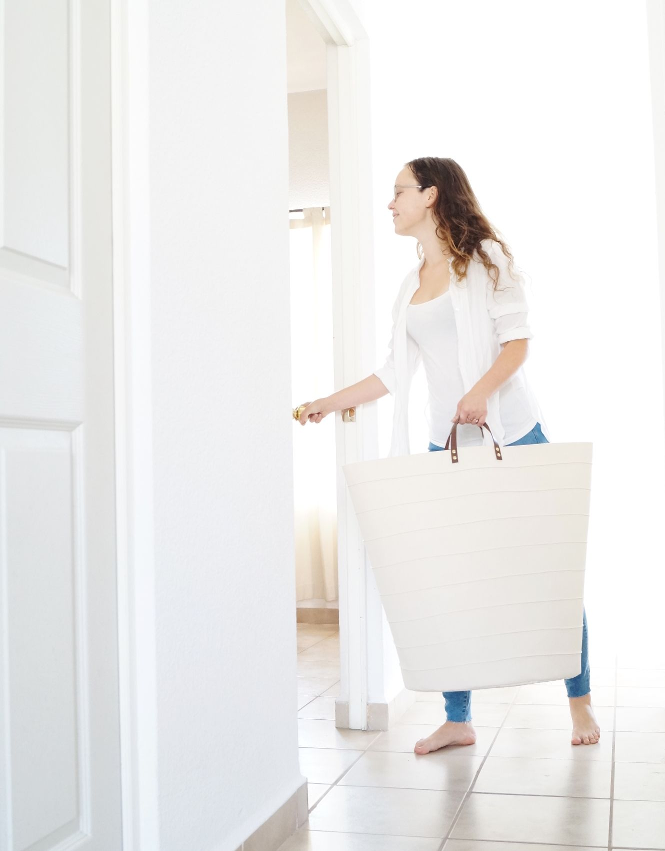 Large laundry hamper. Oversized storage basket. Minimalistic white ...