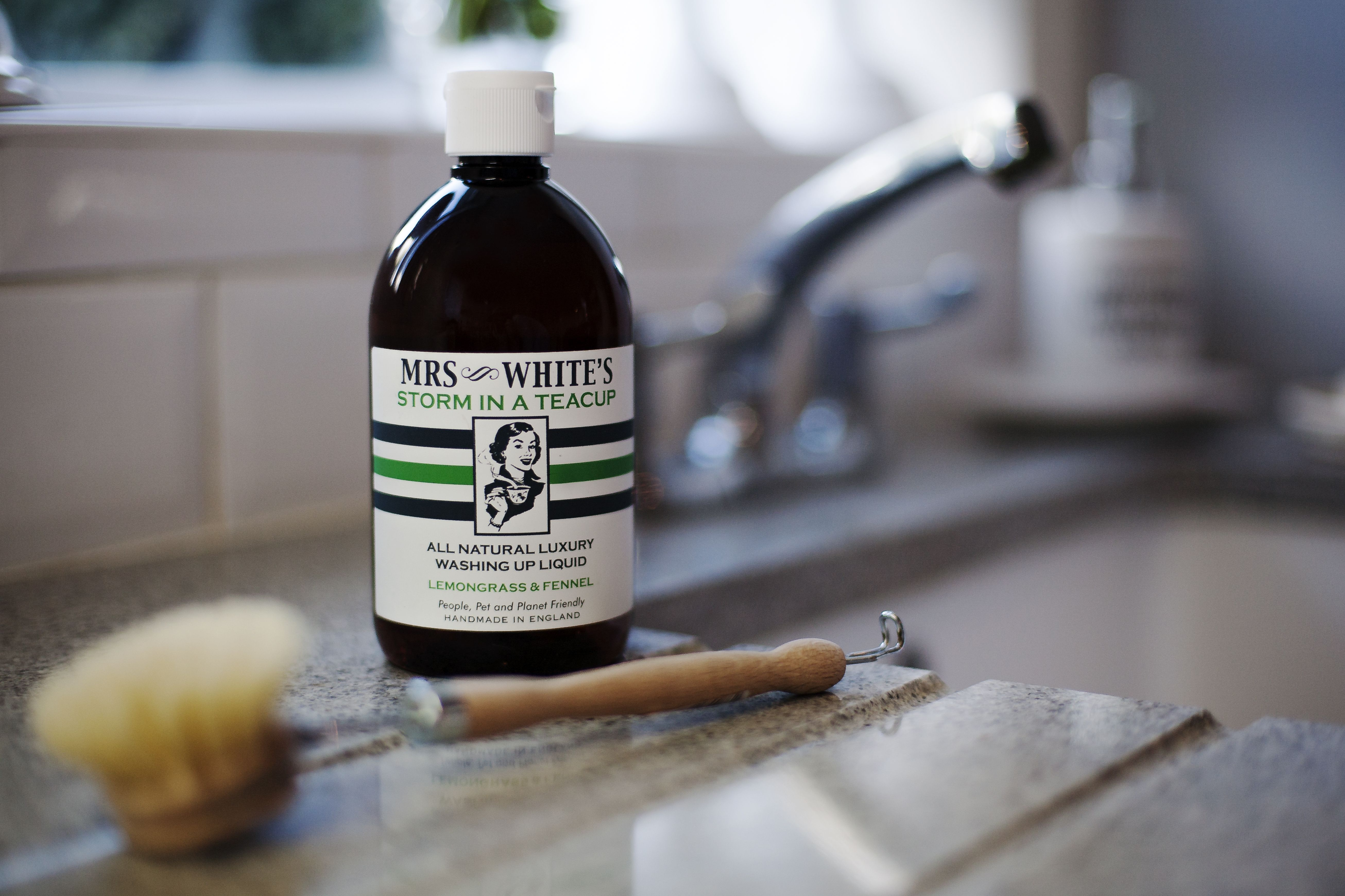 """Mrs White's """"Storm in a Teacup"""" all natural washing up liquid uses traditional recipes handed down through our family to ensure an all natural clean that will leave your dishes as spotless as your conscience. Our products are chemical free."""