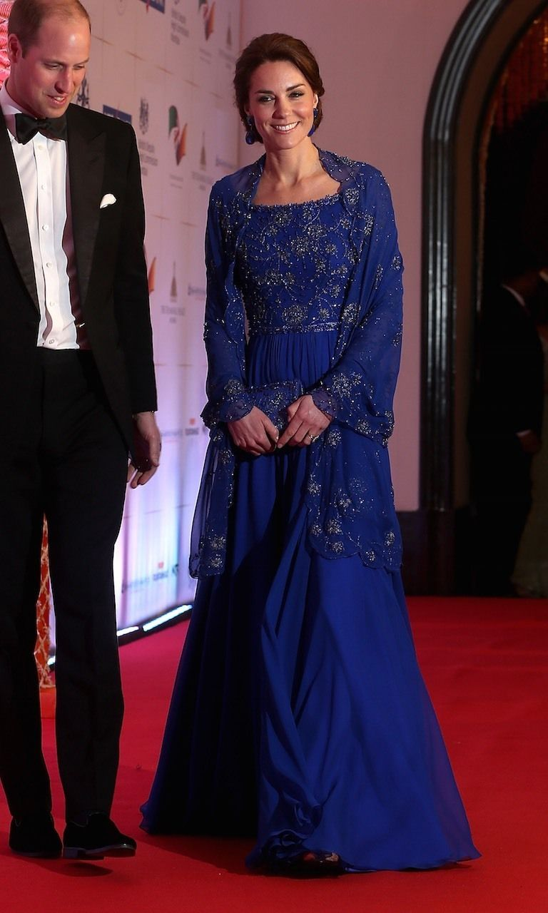 56cb712506c2 On the first night of their royal tour in India and Bhutan, Kate pulled out  all the stops, wearing a sapphire-blue Indian-inspired bespoke gown  designed by ...