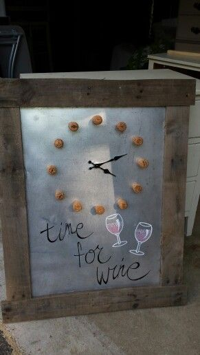 Time for wine click made from leftover sheet metal, corks and pallet