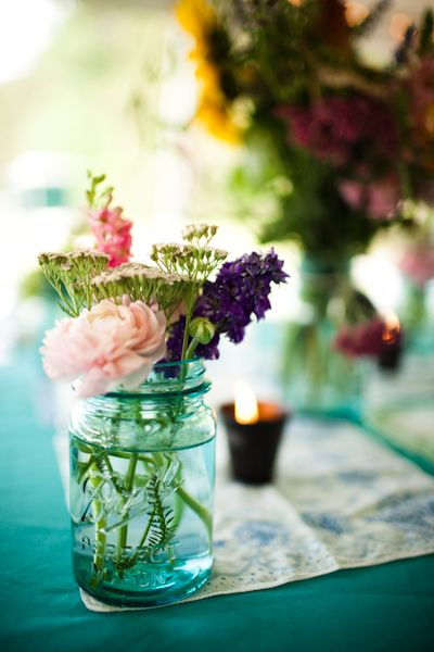 Lovely colors, simple bouquets for tables etc. Guests can take home bouquet and mason jars (tip: several brands of spaghetti sauce come in mason jars -- wash and save for later use).