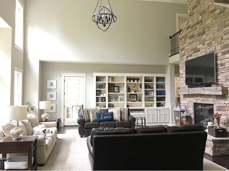 Man Cave Kristan Green : Modern farmhouse living room with vaulted ceilings orb chandelier