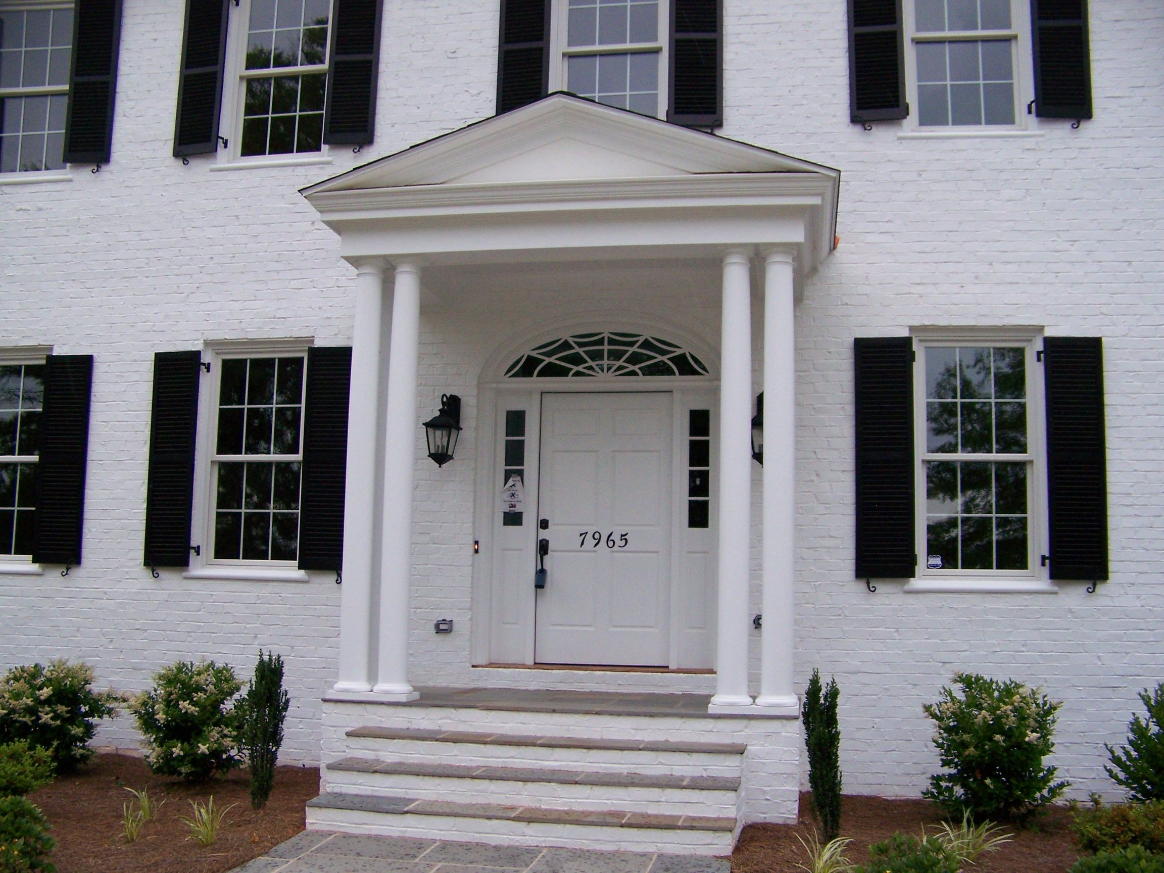 white brick house with porch | saw a house that had a portico