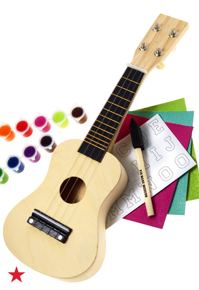 Let your little one get in tune with their musical side. This Kid Made Modern ukulele stencil kit includes everything they need to create a custom design before they start playing the ukulele. Visit macys.com for more kid appropriate musical toys!