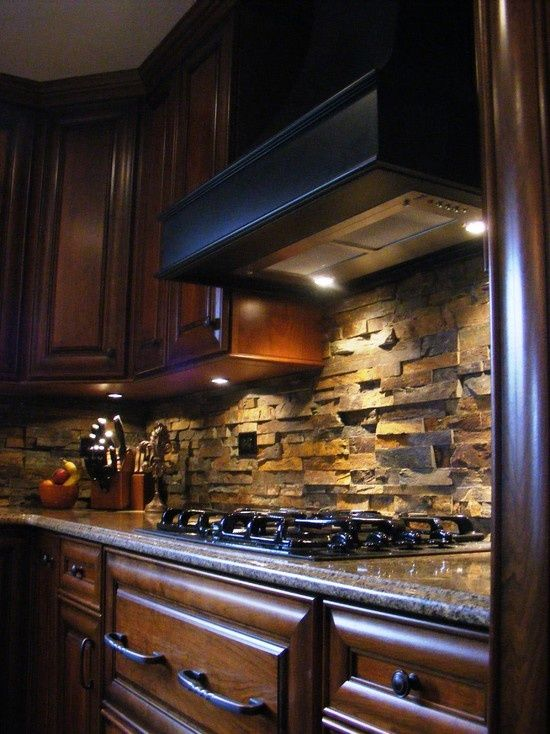stone backsplash ads texture and depth in an otherwise
