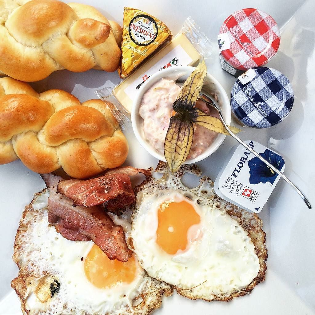 First stop in Zurich? The historic Café Odeon for a Swiss breakfast with crispy fried eggs speck and a bowl of muesli. #SwissHits @flyswiss by tastingtable