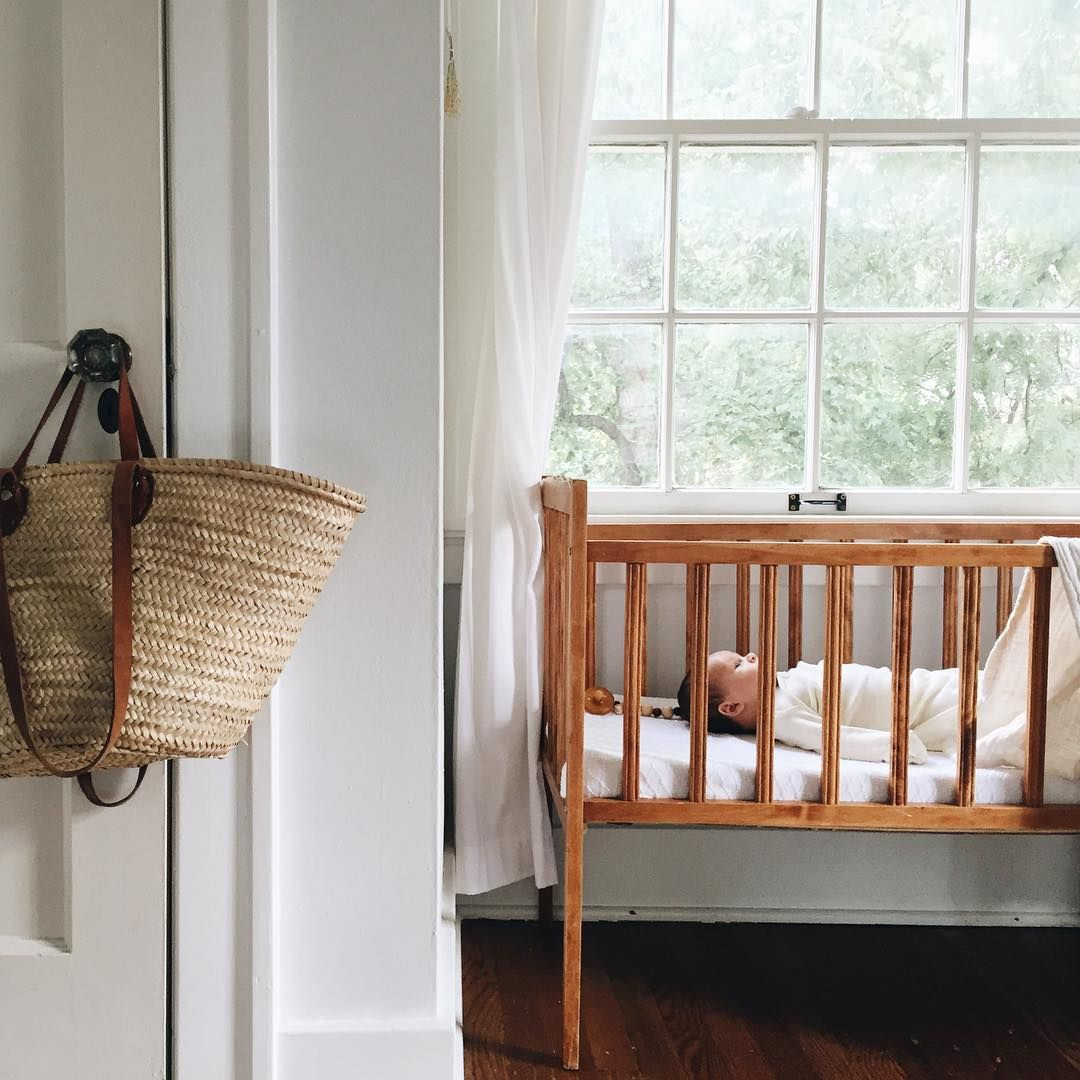 he wakes each morning in his great nana's crib, grunting and squeaking as the sun comes up