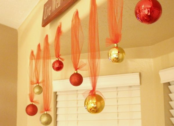 an idea for hanging decorations in our living room bay window or ...